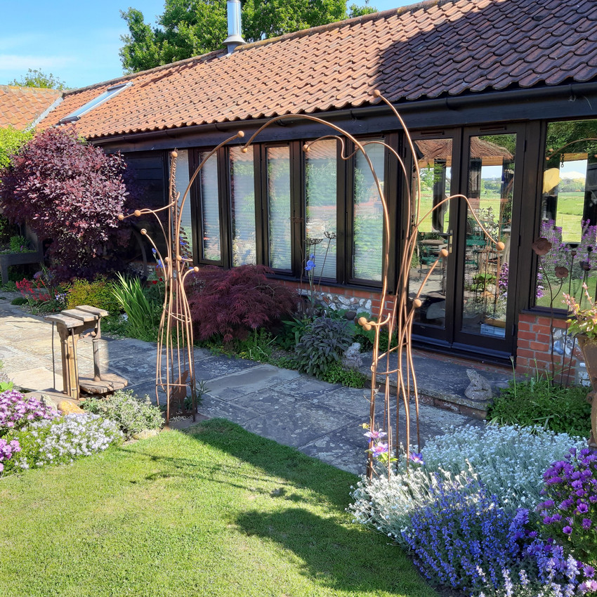 Archways in customers' barn garden