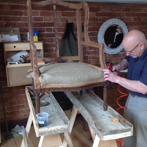 Ken upholstering a chair