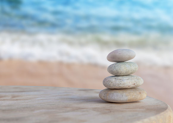 Balance of Life stones by the ocean