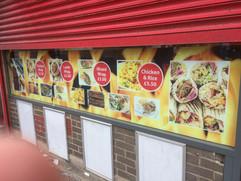pizza shop window advertising