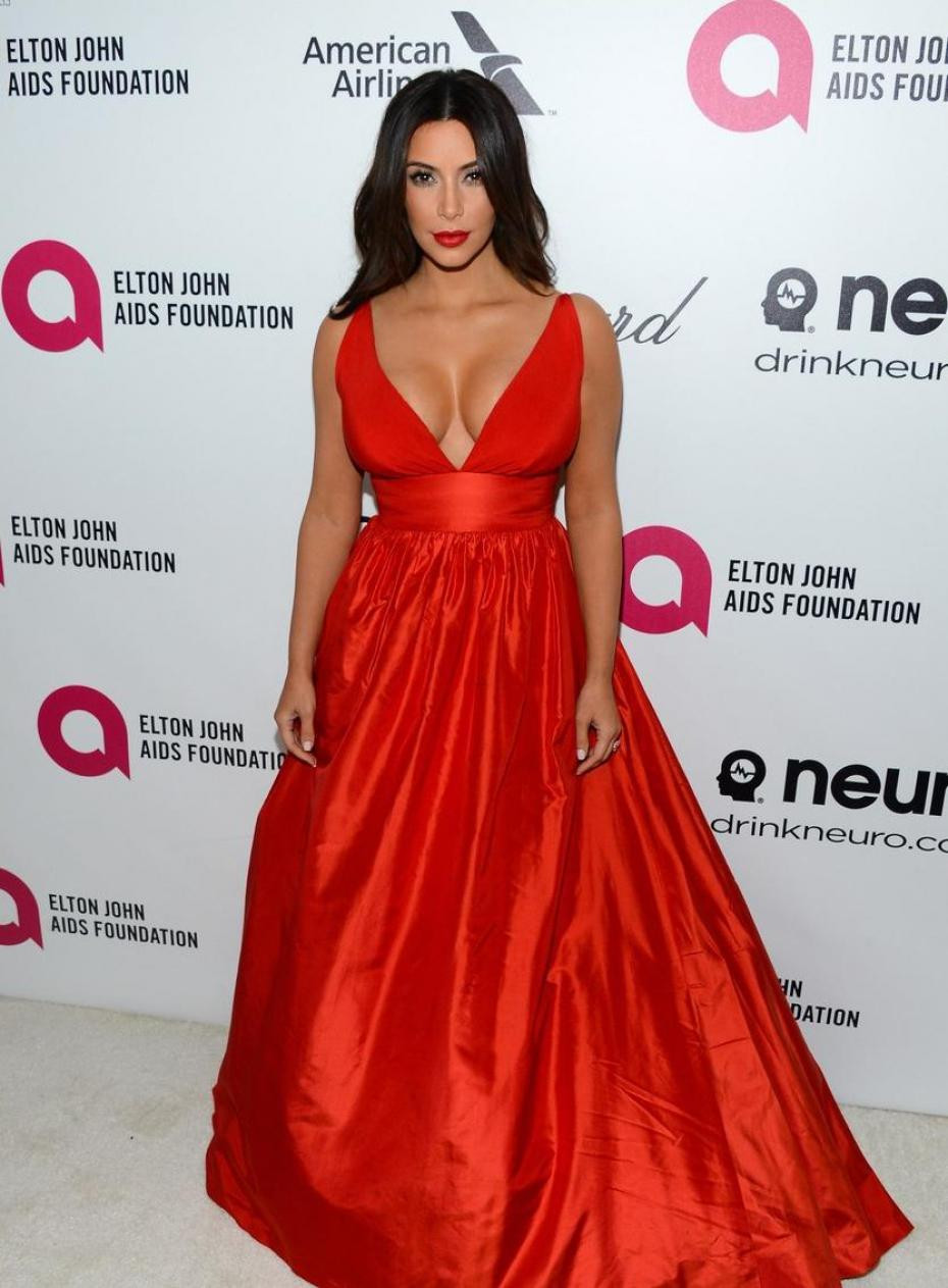 The game changer  Kim Kardashin in the glorious red Celia Kritharioti Haute  Couture ballroom dress at the Elton John AIDS Foundation 2014 Oscars Viewin  ... 652a0f28b53