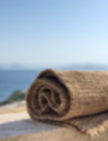 Try a flat woven rug for a ceremony by the sea in Mykonos