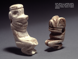 Amulet figures in a squatting position