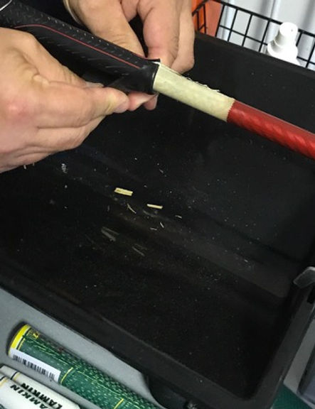Golf Club Regripping Service | Raliegh, NC | Removing old grip from shaft