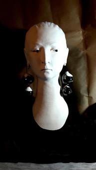 Head of woman with earrings