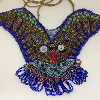 Bead embroidered owl necklace, bird in flight