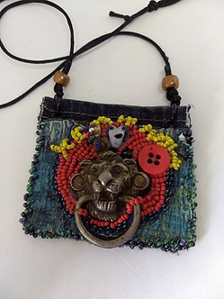 Reclaimed lion head on beaded fabric necklace, adjustable length cord necklace
