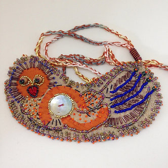Bird on bead embroidered fabric bib necklace