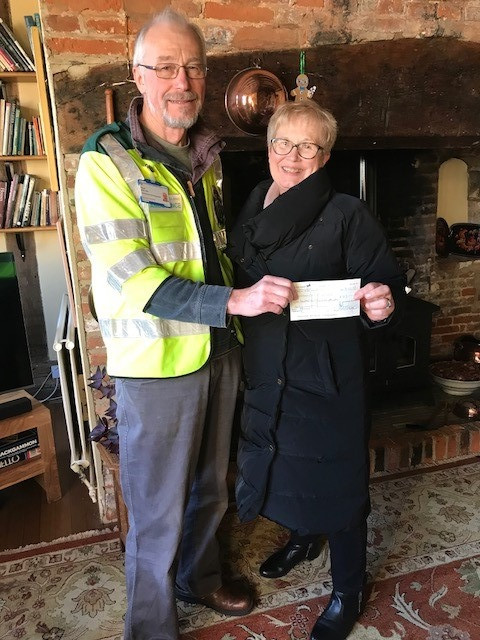 Handing over a cheque for £117 to Lavenham First Responders