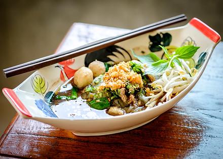 Thai noodle soup (Kuay Tiew Ruer). Serve