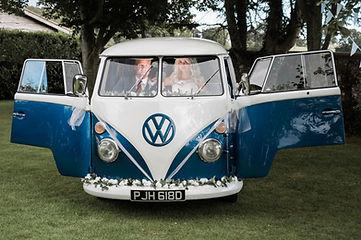 Wedding Car Hire Sussex Vintage VW Splitscreen Bus front image with couple inside Selden Barns