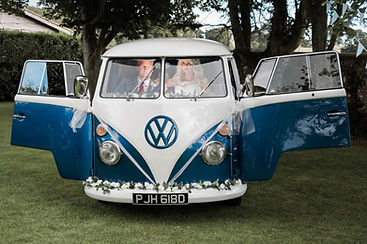 Wedding Car Hire Sussex Vintage VW Splitscreen Bus front image with couple inside Selden Barns