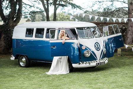 Wedding Car Hire Sussex Vintage VW Splitscreen Bus with doors open at Selden Barns