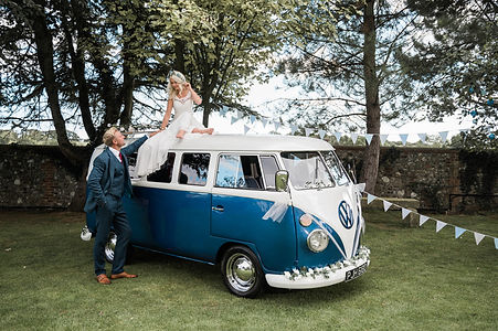 Wedding Car Hire Sussex Vintage VW Splitscreen Bus front image with bride on roof 2 at Selden Barns
