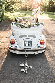Wedding Car Hire Sussex Vintage VW Beetle rear shot with tin cans image at Selden Barns
