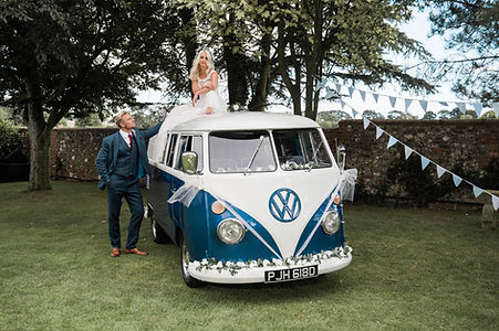 Wedding Car Hire Sussex Vintage VW Splitscreen Bus front image with bride on roof at Selden Barns