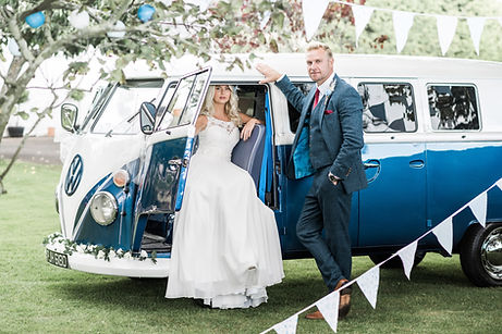Wedding Car Hire Sussex Vintage VW Splitscreen Bus side image with couple Selden Barns