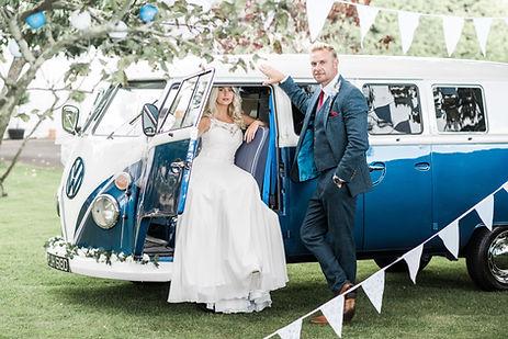 Wedding Car Hire Sussex Vintage VW Splitscreen Bus side image with couple Selden Barns