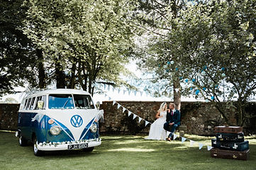 Wedding Car Hire Sussex Vintage VW Splitscreen Bus front image with couple seated at Selden Barns