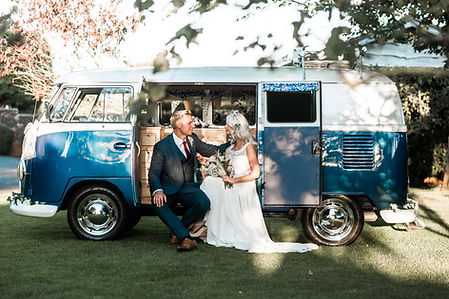 Wedding Car Hire Sussex Vintage VW Splitscreen Bus side image with bride & groom at Selden Barns