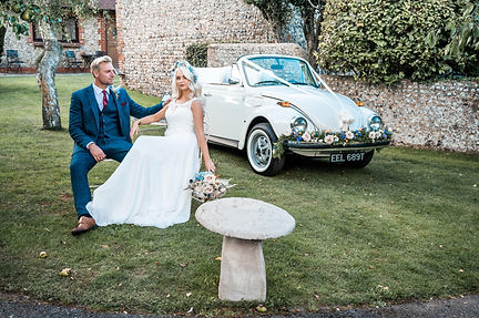 Wedding Car Hire Sussex Vintage VW Beetle couple seated at Selden Barns