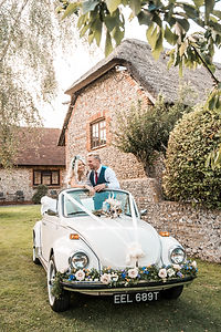 Wedding Car Hire Sussex Vintage VW Beetle front image with couple Selden Barns