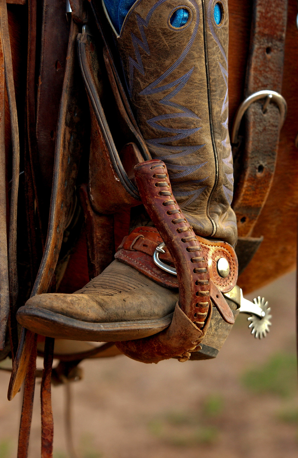 cowboy boot in stirrups