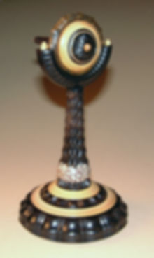 Spinning top on matching stand