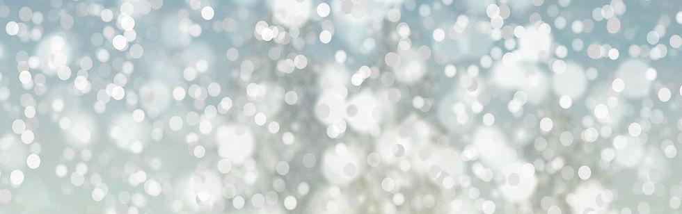 Blå bakgrundsbild med glittriga prickar