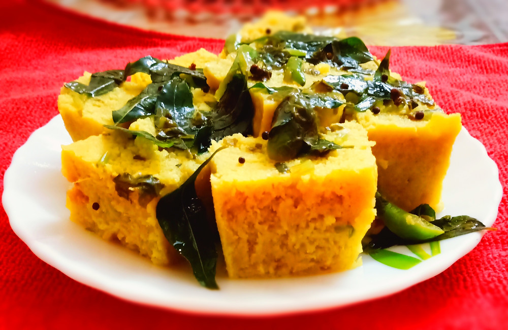 Dhokla is a food common in the Gujarat state of India. It is made from soaked and freshly ground channa dal or channa flour Khaman Dhokla is very popular in India.