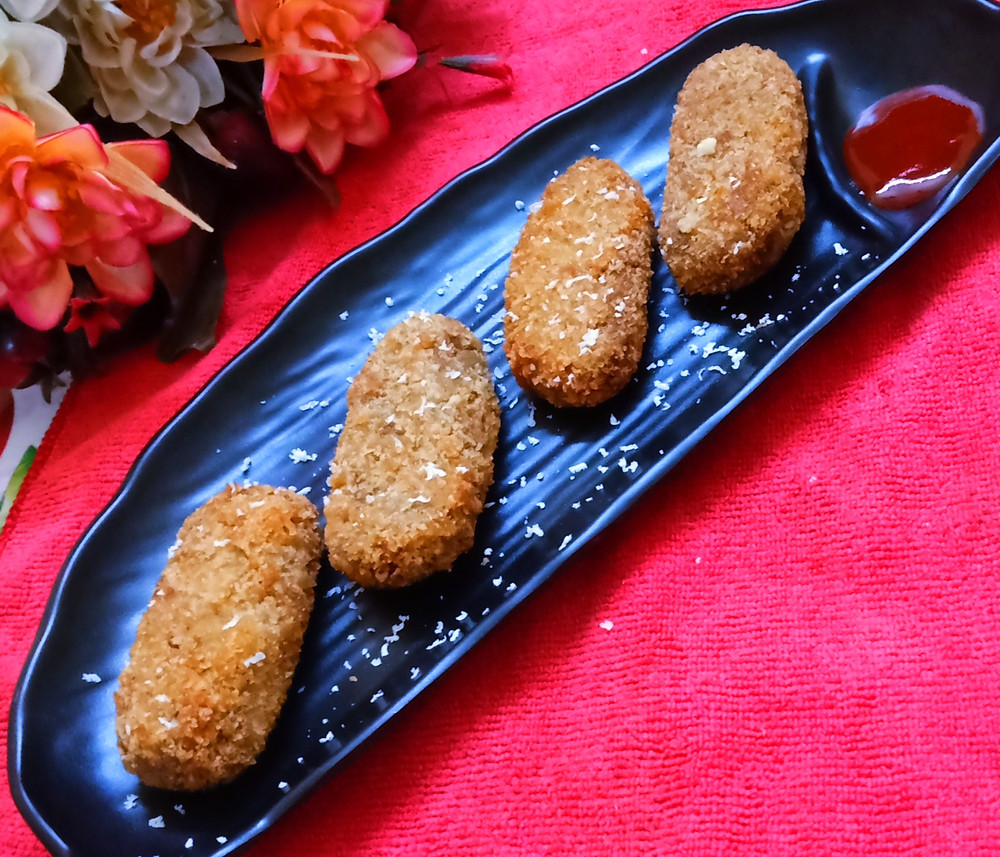 Fish Chop is a delicious Bengali style fish croquettes that are usually served as a starter at parties.  This recipe can also be served as snacks.