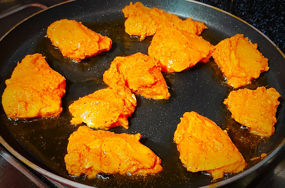 Chicken tikka masala is a dish consisting of roasted marinated chicken chunks in spiced curry sauce. The curry is usually creamy and orange-coloured. It consists of Ginger garlic paste, Lemon juice, Whisked curd, Kashmiri red chili powder, Garam masala, Refined/olive oil.