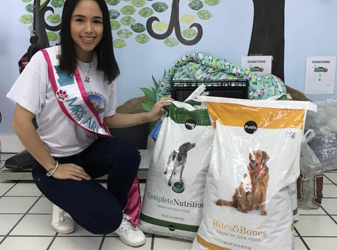 Mrs. Art Deco delivers pet donations at Paws 4 You.
