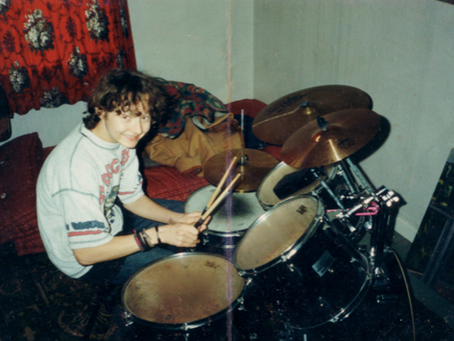 GEORGE PLAYING THE DRUMS
