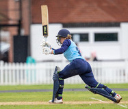 Elise Good hits out as rain begins to fa