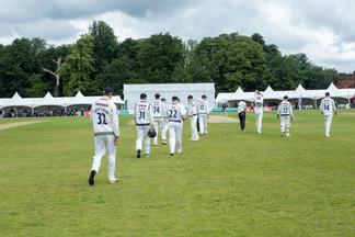 Team walking on to field_H9A0892.jpg