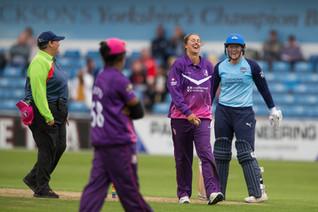 Hollie Armitage, Jenny Gunn & the umpire