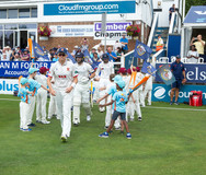 YCCC batsmen walking out on Day 1_H9A140