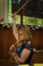 Kathy conducting violin recital.