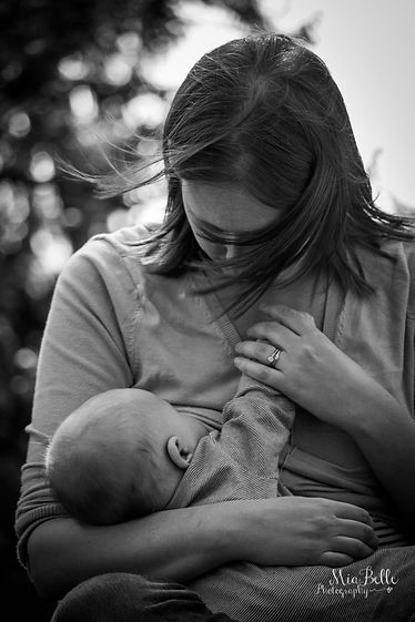 woman breastfeeding baby, loving mother, mamas milk, black and white photography, dunham massey, family photoshoot, family portrait, outdoor portrait, natural light photography, candid photography, stockport photographer, manchster photographer, trafford photographer