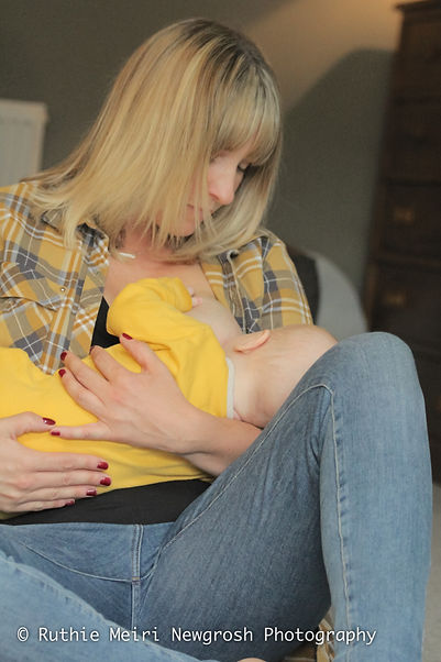 woman breastfeeding, woman nursing, mummy milk, mama milk, yellow babygrow, breastfeeding photography, breastfeeding photographer, breastfeeding stockport, breastfeeding manchester