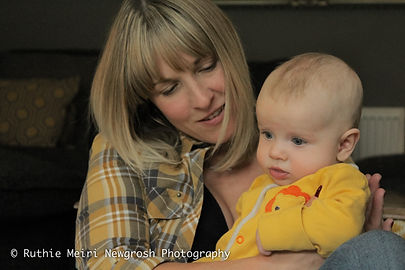 woman breastfeeding, woman nursing, mummy milk, mama milk, yellow babygrow, breastfeeding photography, breastfeeding photographer, breastfeeding stockport, breastfeeding manchester, mummy and baby, mama and me