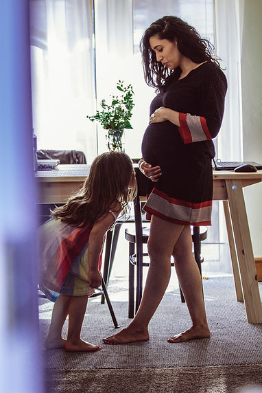 pregnant mother with daughter