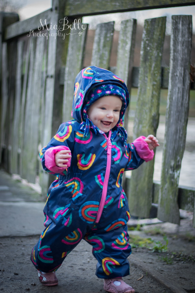 a baby walking and very happy