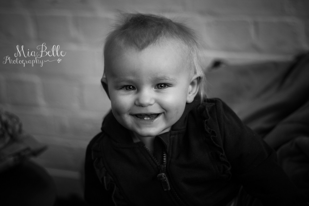 happy baby in a black and white image