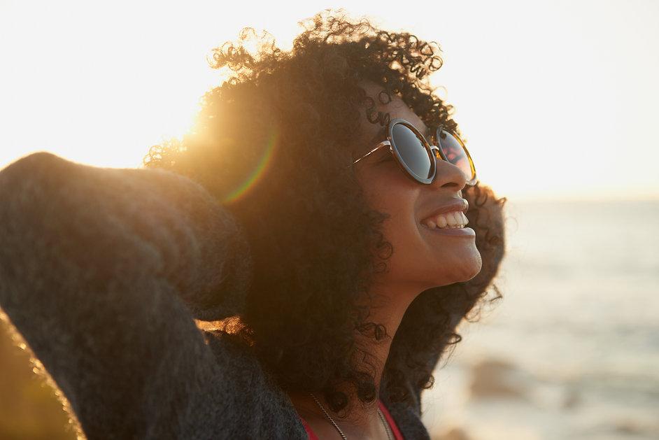 Woman on beach smiling.jpg