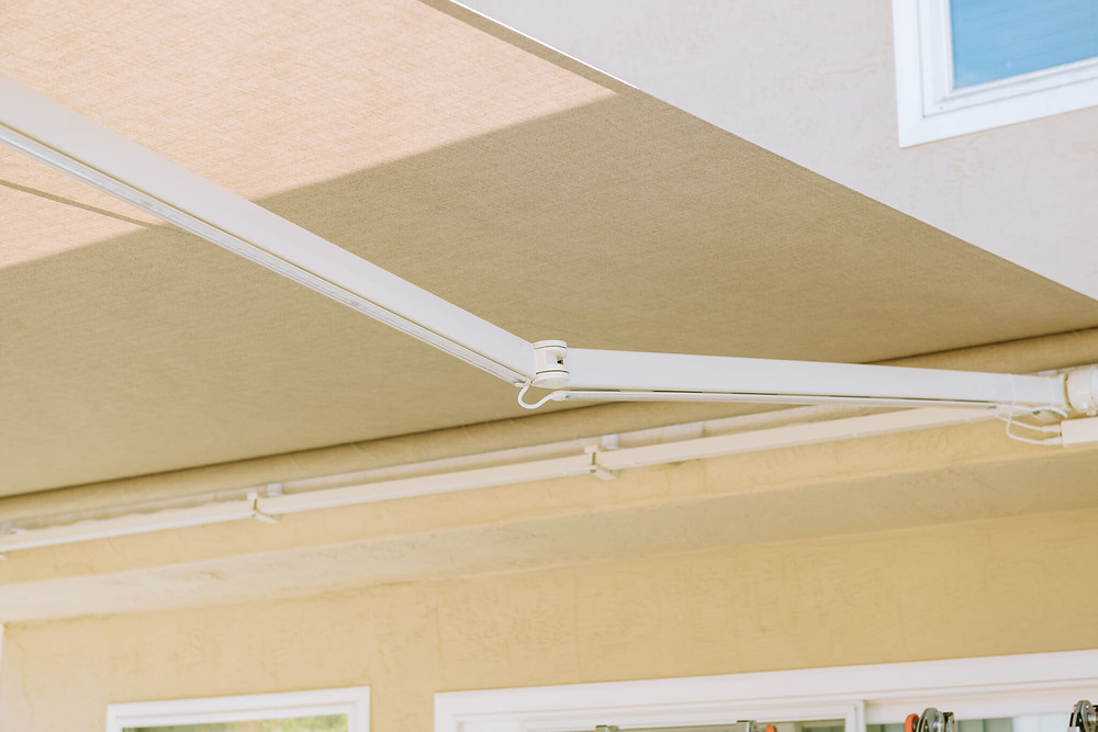 """This SunSetter awning is fully extended and the """"elbow"""" or the metal arms, are locked into position. When locked, the arm will have a slight bend."""