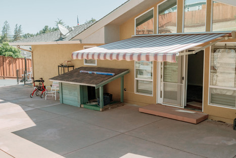 SunSetter awning, Western Red fabric, wave cut
