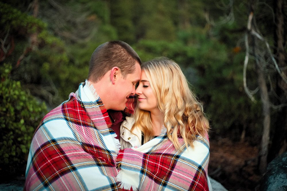 couple with blanket engagement photography