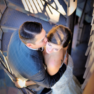 wedding day kiss on the stairs